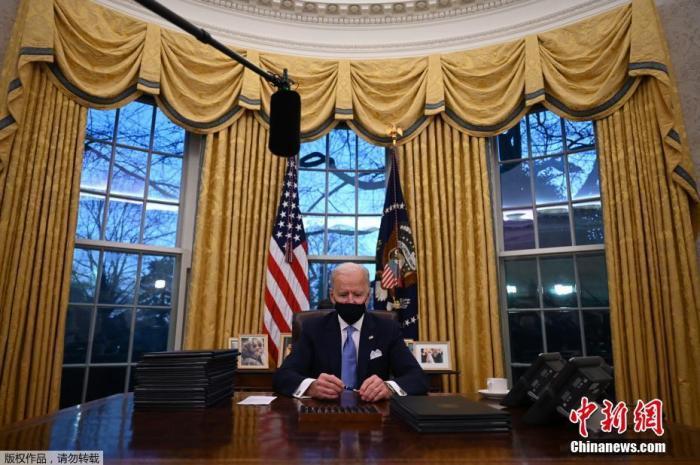 Biden signs executive order condemning racism:
