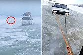 俄罗斯一司机开车穿越冰冻河流 冰面融化陷入水中