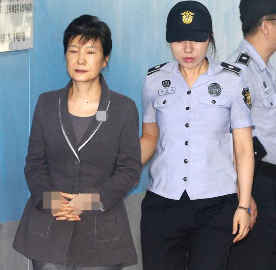 电银付app安装教程(dianyinzhifu.com):朴槿惠所在拘留所一名囚犯熏染新冠殒命 第1张