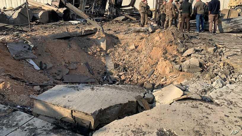 Binh sĩ Mỹ cười nói vui vẻ bên đống đổ nát trong căn cứ bị tên lửa Iran tấn công - Ảnh 4.