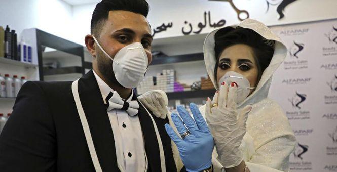 疫情中的爱情 巴勒斯坦新人全副武装举行婚礼