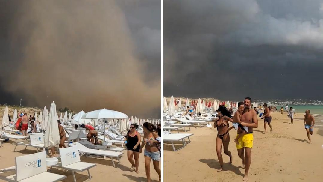 巨大沙尘暴席卷意大利海滩 游客纷纷逃窜