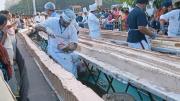泰国1500红烘焙师做出6.5米长蛋糕开展成为世界最长
